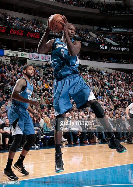 Gorgui Dieng of the Minnesota Timberwolves grabs a rebound against the Dallas Mavericks on February 2 2015 at the American Airlines Center in Dallas...