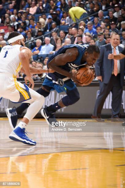 Gorgui Dieng of the Minnesota Timberwolves handles the ball against the Golden State Warriors on November 8 2017 at ORACLE Arena in Oakland...