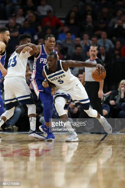 Gorgui Dieng of the Minnesota Timberwolves handles the ball against the Philadelphia 76ers on December 12 2017 at Target Center in Minneapolis...