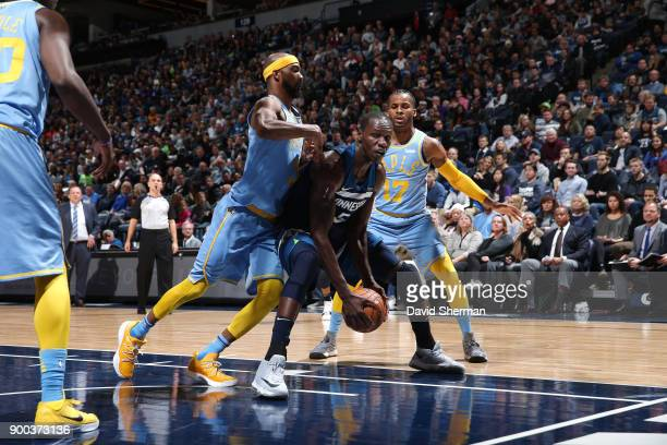 Gorgui Dieng of the Minnesota Timberwolves handles the ball against the Los Angeles Lakers on January 1 2018 at Target Center in Minneapolis...