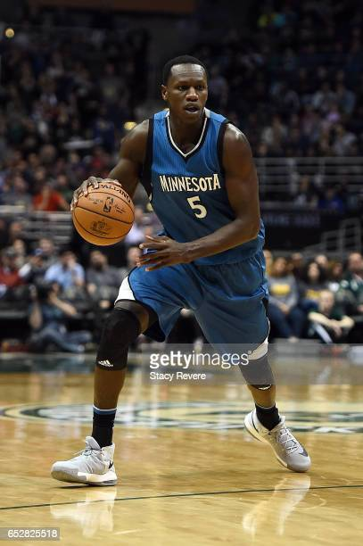 Gorgui Dieng of the Minnesota Timberwolves handles the ball during a game against the Milwaukee Bucks at the BMO Harris Bradley Center on March 11...