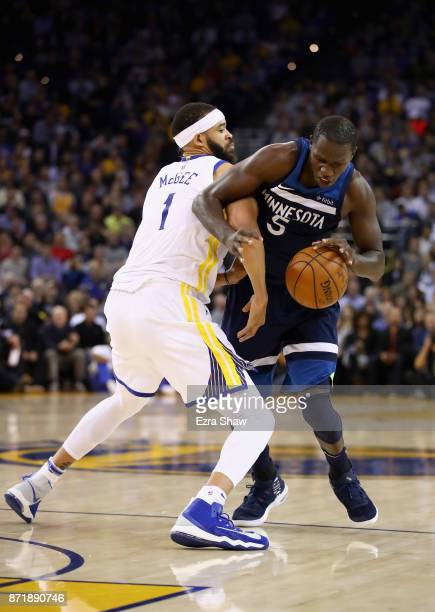 Gorgui Dieng of the Minnesota Timberwolves is covered by JaVale McGee of the Golden State Warriors at ORACLE Arena on November 8 2017 in Oakland...