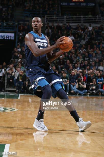 Gorgui Dieng of the Minnesota Timberwolves looks to pass the ball against the Milwaukee Bucks on December 28 2017 at the BMO Harris Bradley Center in...