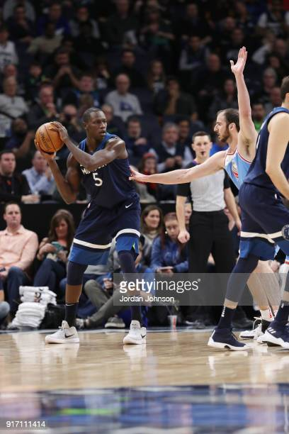 Gorgui Dieng of the Minnesota Timberwolves passes the ball against the Sacramento Kings on February 11 2018 at Target Center in Minneapolis Minnesota...