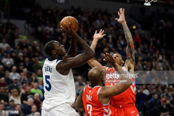 Gorgui Dieng of the Minnesota Timberwolves passes the ball away from Chris Paul and Gerald Green of the Houston Rockets during the game on February...