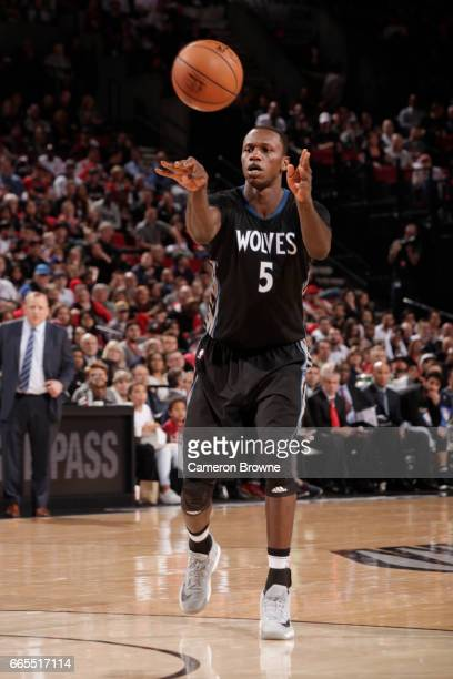 Gorgui Dieng of the Minnesota Timberwolves passes the ball during a game against the Portland Trail Blazers on April 6 2017 at the Moda Center in...