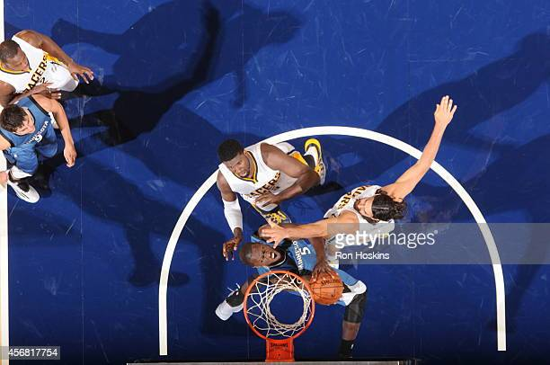 Gorgui Dieng of the Minnesota Timberwolves shoots against the Indiana Pacers at Bankers Life Fieldhouse on October 7 2014 in Indianapolis Indiana...