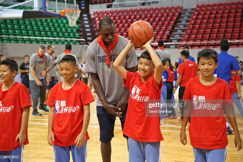 Gorgui Dieng #5 of the Minnesota Timberwovles interacts with the kids during a NBA Cares event as part of the 2017 Global Games China on October 4, 2017 at the Shenzhen Gymnasium in Shenzhen, China.
