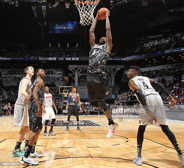 Gorgui Dieng of the World Team goes up to dunk during a game against the US Team during the BBVA Compass Rising Stars Challenge as part of 2015...