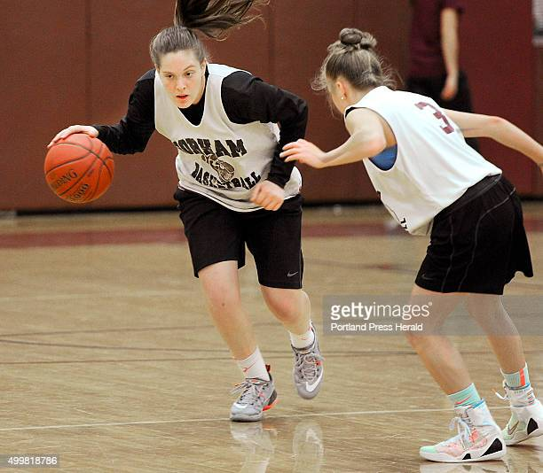 Gorham junior basketball standout Emily Esposito left works on an offensive drill with teammate guard Kaylea Lundin during practice