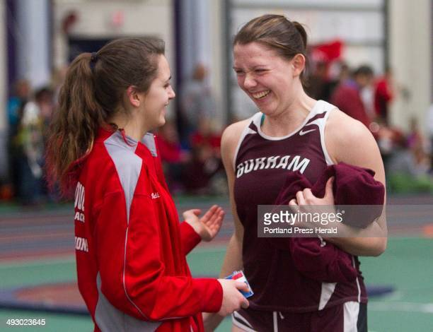 Gorham's Sophia Swiatek celebrates with competitor Sarah Rinaldi of Scarborough after Swiatek won the shot put event during the Maine Class A Indoor...