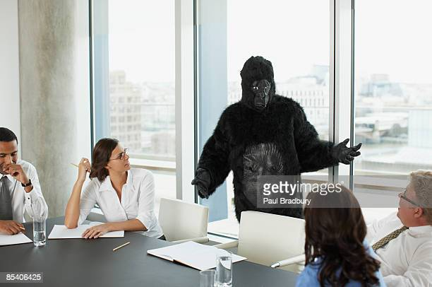 gorilla and businesspeople having meeting in conference room - animal costume stock pictures, royalty-free photos & images