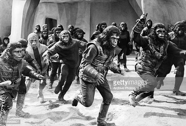 Gorillas and chimps give chase through the city in a scene from the film 'Planet Of The Apes' 1968