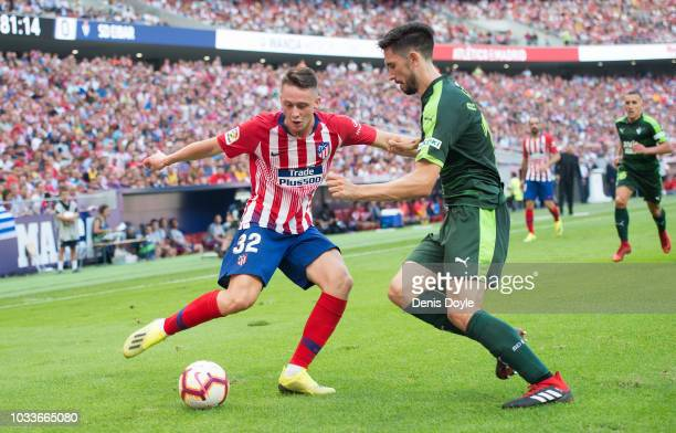 Gorja Garces of Club Atletico de Madrid is challenged by Paulo de Oliveira of SD Eibar during the La Liga match between Club Atletico de Madrid and...