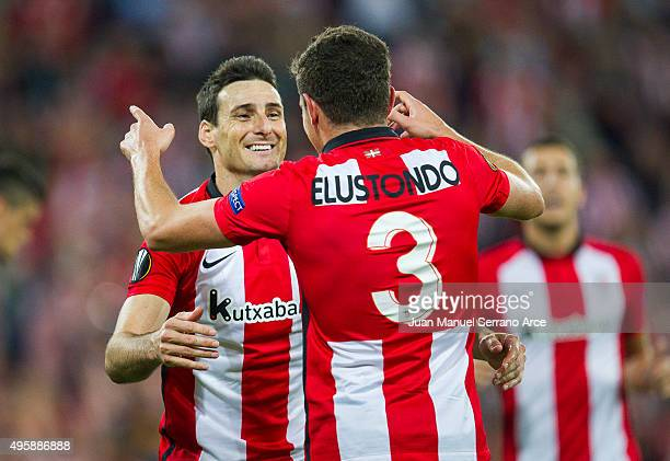 Gorka Elustondo of Athletic Club celebrates with his teammate Aritz Aduriz of Athletic Club after scoring his team's fifth goal during the UEFA...