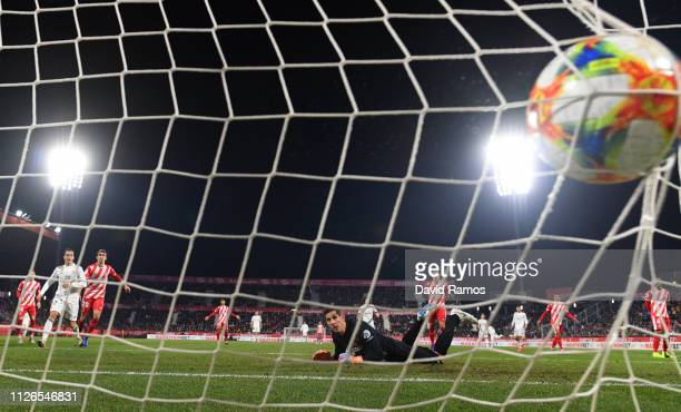 Gorka Iraizoz of Girona looks on as the ball hits the net after Real Madrid's third goal during the Copa del Quarter Final match between Girona and...
