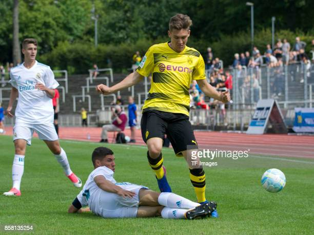 Gorka Zabarte Moreno of Real Madrid and Florian Rausch of Dortmund battle for the ball during the EMKA RUHRCup International Final match between...