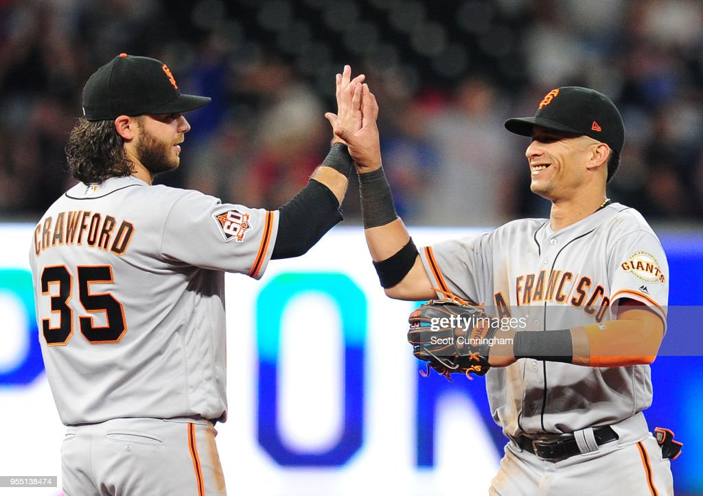 Gorkys Hernandez #7 and Brandon Crawford #35 of the San Francisco Giants celebrate after the game against the Atlanta Braves at SunTrust Park on May 5, 2018 in Atlanta, Georgia.