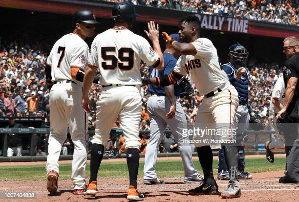 Gorkys Hernandez Andrew Suarez and Andrew McCutchen of the San Francisco Giants celebrate after they all scored on a bases loaded threerun rbi double...