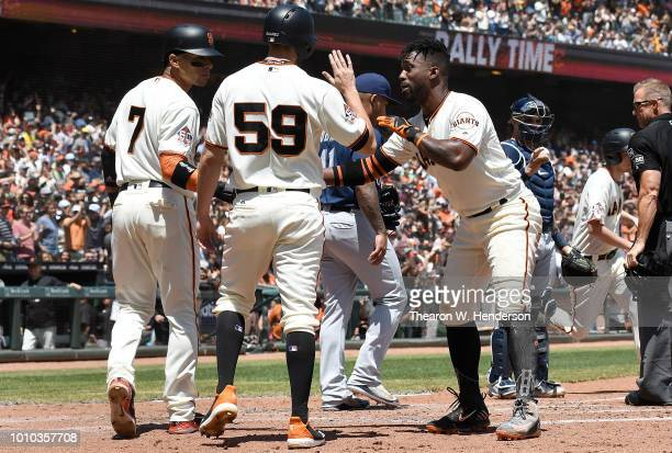 Gorkys Hernandez Andrew Suarez and Andrew McCutchen of the San Francisco Giants celebrates after they all scored on a bases loaded threerun rbi...