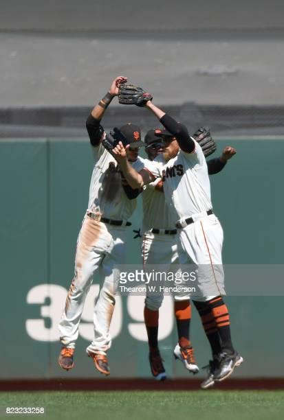 Gorkys Hernandez Denard Span and Hunter Pence of the San Francisco Giants celebrates defeating the Pittsburgh Pirates 21 at ATT Park on July 26 2017...