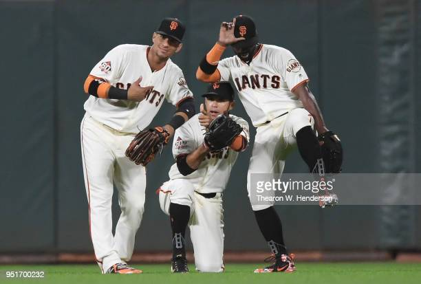 Gorkys Hernandez Gregor Blanco and Andrew McCutchen of the San Francisco Giants celebrates defeating the Washington Nationals 43 at ATT Park on April...