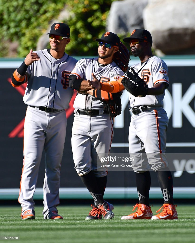 Gorkys Hernandez #7, Gregor Blanco #1 and Andrew McCutchen #22 of the San Francisco Giants pose in the outfield after the final out of the game against the Los Angeles Angels of Anaheim at Angel Stadium on April 22, 2018 in Anaheim, California.