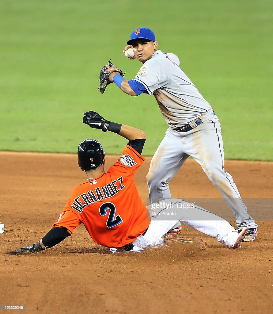 Gorkys Hernandez #2 of the Miami Marlins is doubled off second base by Ruben Tejada #11 of the New York Mets at Marlins Park on October 3, 2012 in Miami, Florida.