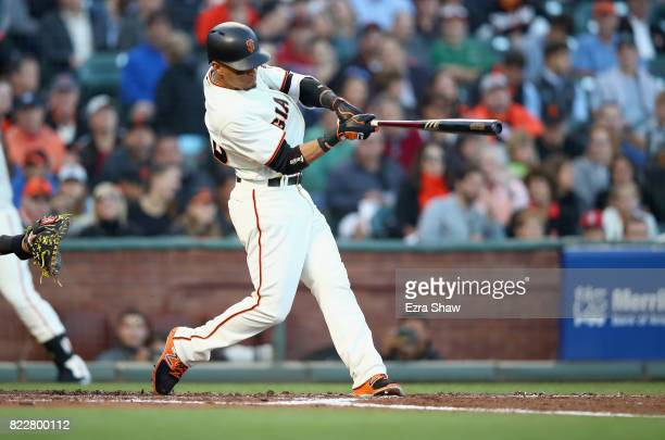 Gorkys Hernandez of the San Francisco Giants hits in to a ground out but scores Brandon Crawford in the second inning against the Pittsburgh Pirates...