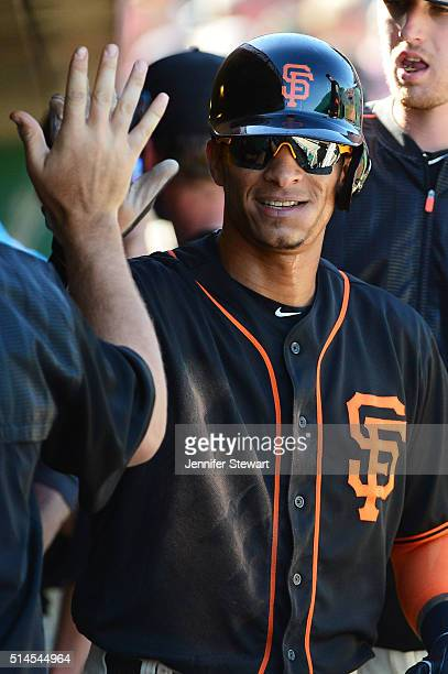 Gorkys Hernandez of the San Francisco Giants is congratulated by teammates after scoring in the fifth inning against the Colorado Rockies during the...