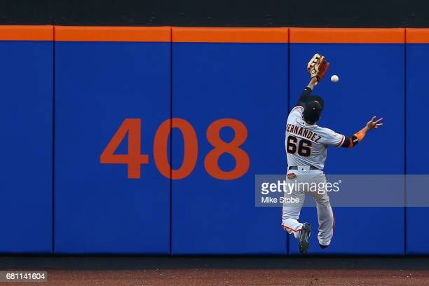 Gorkys Hernandez of the San Francisco Giants is unble to catch a RBI double in the first inning off the bat of Rene Rivera of the New York Mets at...