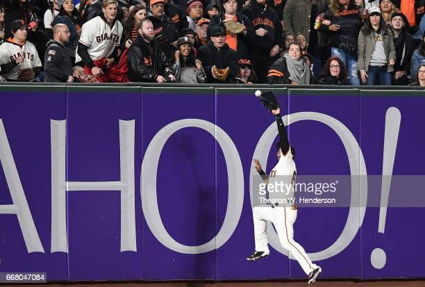 Gorkys Hernandez of the San Francisco Giants leaps into the wall but can't make the catch of this ball that goes for a bases loaded threerun rbi...