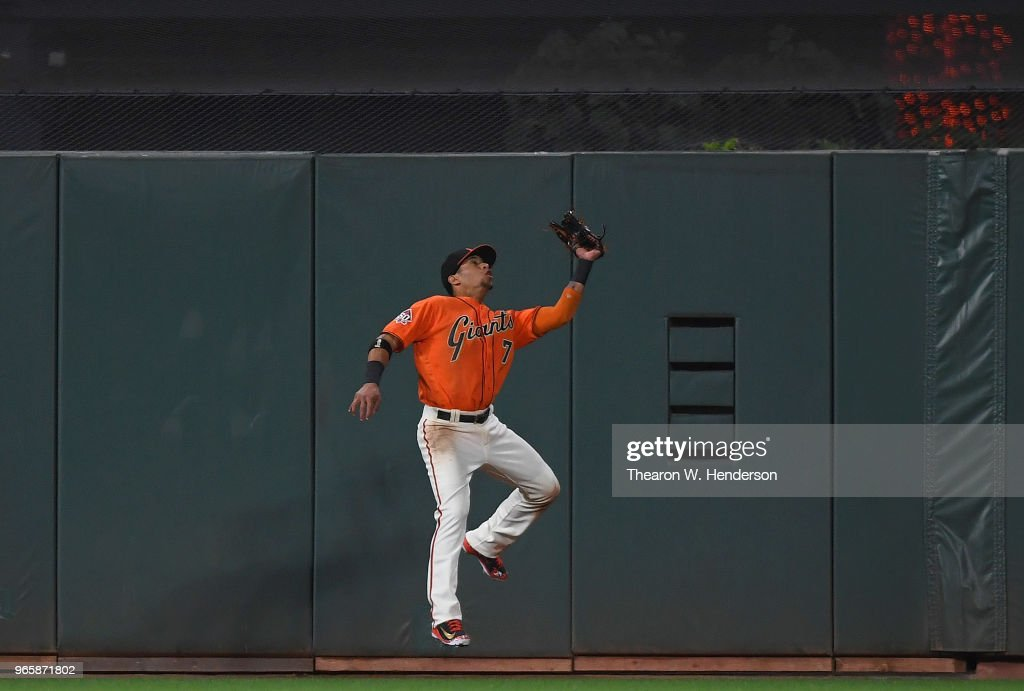 Gorkys Hernandez #7 of the San Francisco Giants makes a leaping catch at the wall taking a hit away from Scott Kingery #4 of the Philadelphia Phillies in the top six inning at AT&T Park on June 1, 2018 in San Francisco, California.