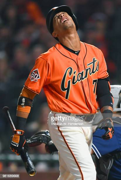 Gorkys Hernandez of the San Francisco Giants reacts after a pitch was called a strike while he was batting against the San Diego Padres in the bottom...