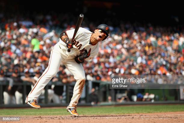 Gorkys Hernandez of the San Francisco Giants reacts after being hit by a pitch in the seventh inning against the Milwaukee Brewers at ATT Park on...