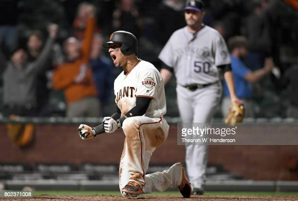 Gorkys Hernandez of the San Francisco Giants reacts after he sccored the winning run against the Colorado Rockies in the bottom of the 14th inning at...