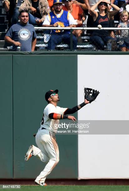 Gorkys Hernandez of the San Francisco Giants runs down a fly ball off the bat of Stephen Piscotty of the St Louis Cardinals in the top of the seventh...