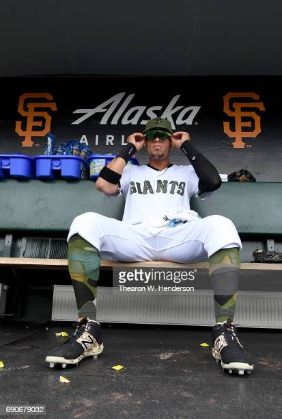 Gorkys Hernandez of the San Francisco Giants sits in the dugout and looks on prior to the start of his game against the Atlanta Braves at ATT Park on...