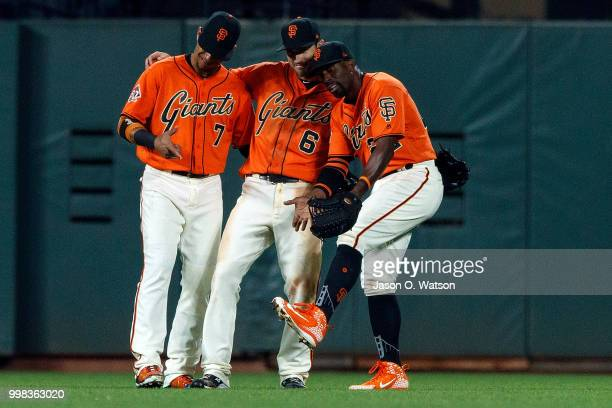 Gorkys Hernandez of the San Francisco Giants Steven Duggar and Andrew McCutchen celebrate after the game against the Oakland Athletics at ATT Park on...