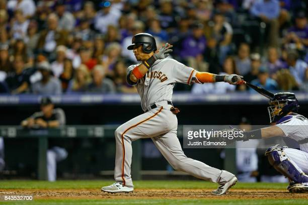 Gorkys Hernandez of the San Francisco Giants watches his two RBI single during the fourth inning against the Colorado Rockies at Coors Field on...