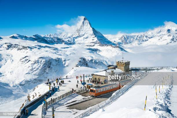 gornergrat railway station switzerland in winter - european alps stock photos and pictures
