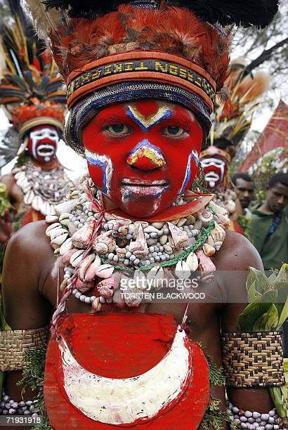 A Kora child wears a kina shell breastplate during the 50th Goroka singsing in what is believed to be the largest gathering of indigenous tribes in...