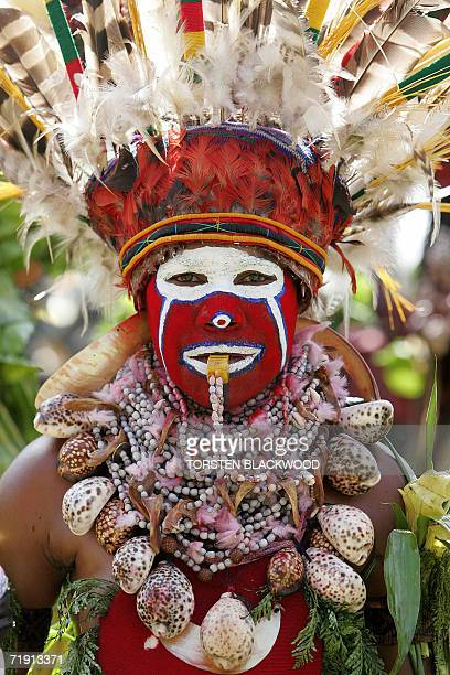 A Kukulka Amps woman from Mt Hagen blows a whistle while performing in the 50th Goroka singsing in what is believed to be the largest gathering of...