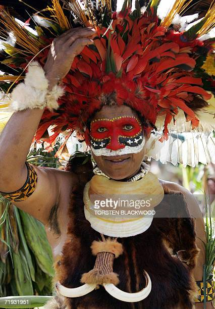 A Kukulka Amps woman reattaches a bird of paradise feather after performing in the 50th Goroka singsing in what is believed to be the largest...