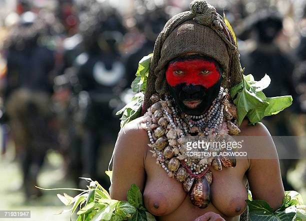A Kukulka Amps woman wears a necklace of Job's tears during the 50th Goroka singsing in what is believed to be the largest gathering of indigenous...