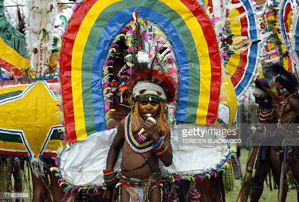 A Rainbow Gahisi boy from Komiufa waits to perform for the 50th Goroka singsing in what is believed to be the largest gathering of indigenous tribes...