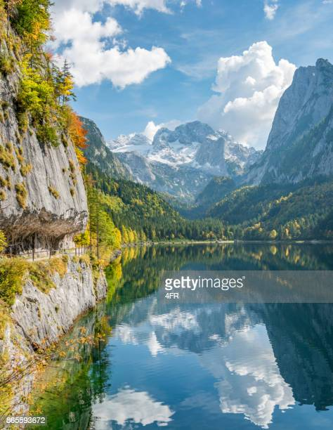 gosausee reflections, beautiful fall colors, dachstein glacier, lake gosau, austria - austria stock pictures, royalty-free photos & images