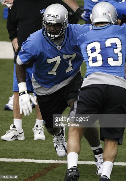 Gosder Cherilus of the Detroit Lions does a drill behind Jawad Nesheiwat during rookie training camp at the Detroit Lions Headquarters and Training...