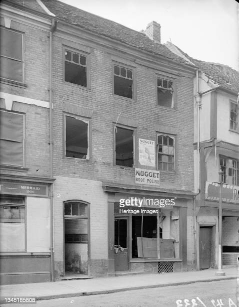 Gosford Street, Coventry, 1941. View showing part of the Mermaid Inn and the premises of Eaves's at 110 Gosford Street showing bomb damage. Coventry...