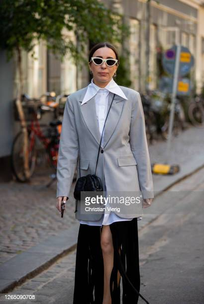 Goisa Boy is seen wearing white button shirt ripped black skirt Bottega bag grey blazer outside Ganni during Copenhagen Fashion Week Spring Summer...